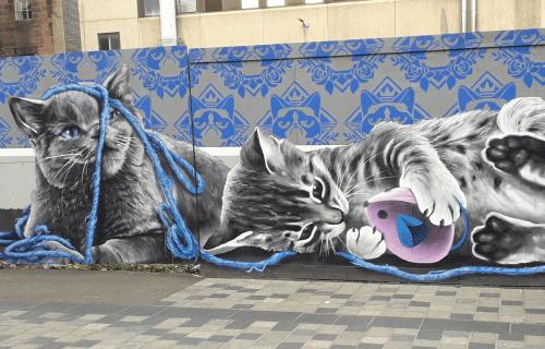 Street art de Smug représentant des chantons